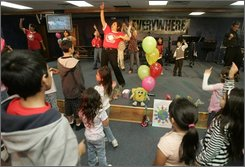 Patricia Mata leads children during services at the New Hope Christian Fellowship Sunday, Oct. 12, 2008 in Greeley, Colo. (AP Photo/Will Powers)