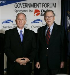 In this Sept. 13, 2008 file photo,  Senate Minority Leader Mitch McConnell of Ky., right, and his Democratic challenger Bruce Lunsford appear together prior to a debate in Erlanger, Ky.  (AP Photo/Ed Reinke, File)