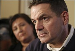 In this Jan. 15, 2008, file photo, Thomas Manion listens to a question from the news media after making the announcement he will run for the Pennsylvania House seat, as his wife Janet looks on, in Doylestown Pa.   Manion, a Republican who is the  father of a Marine killed in Iraq and recently retired as a colonel in the Marine Reserves, is challenging Rep. Patrick Murphy, D-Pa.,the only Iraq war veteran in Congress.  (AP Photo/ Joseph Kaczmarek, file)