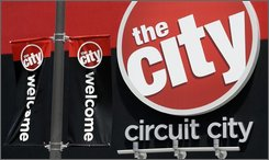 In this April 13, 2008 file photo, a Circuit City sign is seen outside a store in Richmond, Va. Shares of beleaguered electronics retailer Circuit City Stores Inc. rose Monday, Oct. 20, 2008, after a report said the chain may close at least 20 percent of its stores to shore up its finances and avoid filing for bankruptcy protection.  (AP Photo/Steve Helber, file)