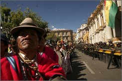A supporter of Bolivia's President Evo Morales tries to get a glimpse of Morales during a protest outside Congress in La Paz, Monday, Oct. 20, 2008.  Protesters marched to demand that Congress enact a referendum on Morales' new proposed constitution. (AP Photo/Dado Galdieri)