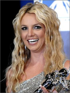 In this Sept. 7, 2008, file photo, Britney Spears poses with her awards backstage at the 2008 MTV Video Music Awards in Los Angeles. (AP Photo/Chris Pizzello, file)