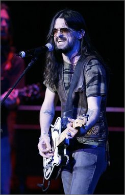 """In this Feb. 8, 2007 file photo, Shooter Jennings performs a song at the Grammy Foundation's 9th Annual Music Preservation Project """"The Soul Country"""" event celebrating the history of country music in Los Angeles. (AP Photo/Kevork Djansezian, file)"""