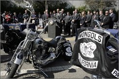 Los Angeles County Sheriff Lee Baca, at podium, speaks during a news conference Tuesday, Oct. 21, 2008, in Los Angeles. Dozens of burly, tattoo-covered Mongol motorcycle gang members were arrested Tuesday by federal agents in six states, including Washington, on warrants ranging from drug sales to murder after a three-year undercover investigation in which four agents successfully infiltrated the group. (AP Photo/Ric Francis)