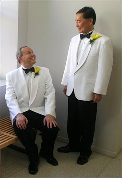 In this Sept. 14, 2008, image originally released by The Rafu Shimpo, Brad Altman, left, and actor George Takei pose for photos on their wedding day at the National Center for the Preservation of Democracy, in the Little Tokyo section of Los Angeles. (AP Photo/The Rafu Shimpo, Mario G. Reyes, file)
