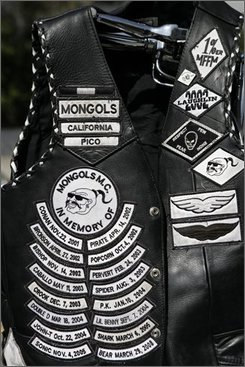 A Mongols' motorcycle gang member vest is displayed during a news conference Tuesday, Oct. 21, 2008, in Los Angeles. Dozens of burly, tattoo-covered Mongol motorcycle gang members were arrested Tuesday by federal agents in six states, including Washington, on warrants ranging from drug sales to murder after a three-year undercover investigation in which four agents successfully infiltrated the group. (AP Photo/Ric Francis)