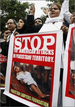  Pakistani lawyers chant slogan during a rally to condemn the U.S. strikes in Pakistani tribal areas, Wednesday, Oct. 22, 2008 in Karachi, Pakistan. (AP Photo/Fareed Khan)