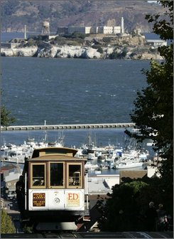 The Powell-Hyde cable car line makes its way up Hyde St. as the Pacific Ocean and Alcatraz Island is seen in the background in San Francisco, Friday, Oct. 10, 2008. (AP Photo/Marcio Jose Sanchez)
