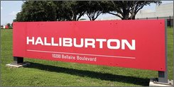  In this July 17, 2006 file photo, a Halliburton complex in far Southwest Houston is seen. Halliburton Co. said Monday, Oct. 20, 2008, it swung to a net loss of $21 million in the third quarter, due largely to the cash settlement of convertible debt. But the oilfield services provider said operating income topped $1 billion for the first time. (AP Photo/Pat Sullivan, File)
