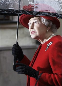 Britain's Queen Elizabeth II looks on from under an umbrella during her walkabout in downtown Bratislava, Slovakia, Thursday, Oct. 23, 2008. Queen Elizabeth II and her husband Prince Philip are in Slovakia for a two-day visit. (AP Photo/Petr David Josek)