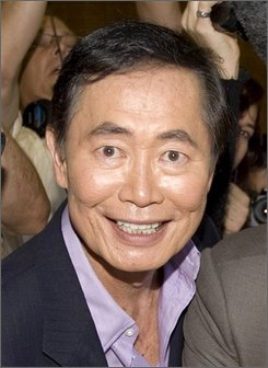 In this June 17, 2008 file photo, actor George Takei, is shown as he gets his marriage certificate permit in West Hollywood, Calif. (AP Photo/Hector Mata, File)