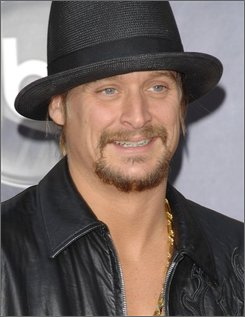In this Nov. 18, 2007 file photo, singer Kid Rock arrives at the American Music Awards in Los Angeles. (AP Photo/Evan Agostini, file)