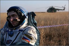 Russian Soyuz space capsule lands on the ground near Arkalyk, in north-central Kazakhstan Friday, Oct. 24, 2008. Space officials say a Soyuz capsule carrying an American and two Russians back to earth has touched down on target in Kazakhstan. (AP Photo/Dmitry Kostyukov, POOL)