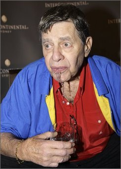 Legendary comedian Jerry Lewis dribbles water as a gag after talking about his touring show in Sydney, Australia, Friday, Oct. 24, 2008. The show, combining anecdotes together with song, and accompanied by a 24-piece orchestra, will open Sunday at the Sydney Opera House. (AP Photo/Rick Rycroft)
