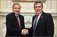 Britain's  Prime Minister Gordon Brown, right,  meets NATO Secretary General Jaap de Hoop Scheffer, inside 10 Downing Street, London  Thursday, Oct. 23,  2008. (AP Photo/Daniel Deme, Pool)