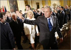 President Bush, right, walks out following the signing Ceremony for the NATO Accession Protocols for Albania and Croatia in the East Room of the White House, Friday, Oct. 24, 2008 in Washington. Walking out behind Bush are from center right to left, Croatian Ambassador to the US Kolinda Grabar-Kitarovic. Albanian Ambassador to the U.S. Aleksander Sallabanda, and NATO Secretary General Jaap de Hoop Scheffer. (AP Photo/Pablo Martinez Monsivais)