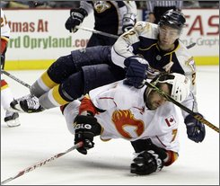 Calgary Flames right wing Todd Bertuzzi (7) collides with Nashville Predators defenseman Dan Hamhuis (2) in the second period of an NHL hockey game in Nashville, Tenn., Thursday, Oct. 23, 2008. (AP Photo/Mark Humphrey)