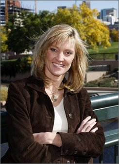 Heidi Van Huysen is shown in Confluence Park along the South Platte River in downtown Denver on Wednesday, Oct. 22, 2008. Van Huysen took a leave from her job as a lawyer for the Colorado Department of Natural Resources to spearhead a campaign against Colorado ballot amendment 52. The campaign is trying to protect a key funding stream for water infrastructure projects in the state. (AP Photo/David Zalubowski)