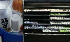 In this Sept 21, 2008 file photo, shelves selling dairy products sit half empty at a WalMart store in Beijing. WalMart Stores Inc., the world's largest retailer, said Wednesday, Oct. 22, 2008 it will set new quality standards for its suppliers amid a scare over toxic milk products that have sickened tens of thousands of babies across China. (AP Photo/ Elizabeth Dalziel, File)
