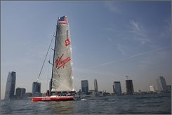 "The yacht ""Virgin Money"" sails down the Hudson River in New York, before attempting to break the trans-Atlantic single-hulled sailing record, in this Thursday Sept. 4, 2008 file photo.  Branson and his two children set out with a crew of champion sailors early Wednesday Oct. 22, 2008 on the 99-foot racing yacht in an attempt to break a trans-Atlantic speed record.  (AP Photo/Ed Ou, FILE)"