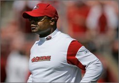  In this Sept. 21, 2008 file photo San Francisco 49ers' assistant head coach Mike Singletary watches practice before an NFL football game against the Detroit Lions in San Francisco. The San Francisco 49ers fired coach Mike Nolan on Monday, Oct. 20, 2008, seven games into his fourth consecutive dismal season with the club, according to FOXsports.com. Assistant head coach Mike Singletary is expected to take over the 49ers. (AP Photo/Jeff Chiu, File)