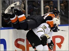 Dallas Stars' Sean Avery, right, upends New York Islanderss Sean Bergenheim during their hockey game Thursday, Oct. 23, 2008 in Uniondale, New York. (AP Photo/Stephen Chernin)