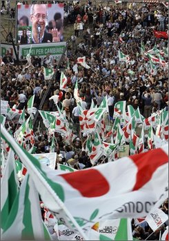 Italy's center-left PD Democratic Party leader Walter Veltroni, on videoscreen at top left, delivers his address to people gathered in Circo Massimo (Circus Maximus) grounds during a rally organized by his party,  in Rome, Saturday, Oct. 25, 2008. The political opponent whom Premier Silvio Berlusconi beat in last spring's election for the premiership in Italy rallied a huge crowd in a protest against the conservative government. A former Rome mayor, Veltroni failed to keep the center-left in power in the last elections. Saturday afternoon, he addressed tens of thousands of protesters in Circus Maximus, the grassy field which was an ancient Roman gathering place. (AP Photo/Pier Paolo Cito)