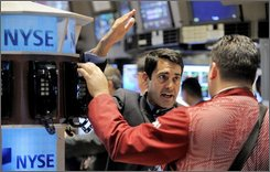 A pair of traders get together on the floor of the New York Stock Exchange, Friday, Oct. 24, 2008. Wall Street capped another difficult week with steep losses Friday, sending the major indexes to their lowest levels in more than five years as markets around the world skidded lower on the belief that a punishing economic recession is at hand. (AP Photo/Richard Drew)