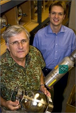This undated handout photo provided by the Scripps Institute shows Scripps geoscientists Ray Weiss, left, and Jens Muehle  in San Diego, Calif., amid collection cylinders used to collect air samples from a variety of locations around the world. Weiss and Muehle led a study that found that the greenhouse gas nitrogen trifluoride, used in the manufacture of flat-panel monitors, escapes to the atmosphere at levels much higher than previously assumed. Two major and potent greenhouse gases are building in the atmosphere, raising an unexpected new threat for accelerating global warming, new studies show. The gases are methane and nitrogen trifluoride, and their levels are building faster than expected. (AP Photo/Scripps Institute, Robert Monroe)