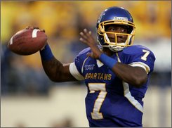 San Jose State quarterback Kyle Reed throws against Boise State during the first half of an NCAA college football game in San Jose, Calif., Friday, Oct. 24, 2008. (AP Photo/Marcio Jose Sanchez)