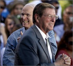Republican presidential candidate Sen. John McCain, R-Ariz., left, and Sen. Pete Domenici, R-N.M., stand together on stage together at a rally in the Old Mesilla Plaza in Mesilla, N.M., Saturday, Oct. 25, 2008. (AP Photo/Carolyn Kaster)