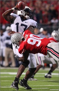 Penn State quarterback Daryll Clark (17) breaks away from Ohio State defensive lineman Thaddeus Gibson (90) during the first quarter of an NCAA college football game Saturday, Oct. 25, 2008 in Columbus, Ohio.  (AP Photo/Terry Gilliam)