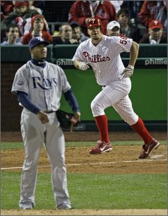 Philadelphia Phillies' Joe Blantonp, right, watches his solo home run off Tampa Bay Rays' Edwin Jackson, left, during the fifth inning of Game 4 of the baseball World Series in Philadelphia, Sunday, Oct. 26, 2008. (AP Photo/Charles Krupa)