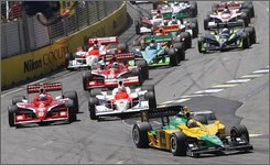 Team Australia's Will Power leads the field into the first chicane at the start of the Indy 300 on the Surfers Paradise street circuit on the Gold Coast in Australia, Sunday, Oct. 26, 2008. (AP Photo/Mark Baker)