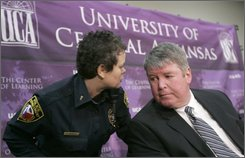 University of Central Arkansas interim President Tom Courtway, right, speaks with UCA Campus Police Lt. Rhonda Swindle before a news conference in Conway, Ark., Monday, Oct. 27, 2008. The campus was the site of a fatal shooting that left two students dead and a third person wounded Sunday. (AP Photo/Danny Johnston)