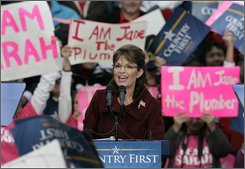Republican vice presidential candidate, Alaska Gov. Sarah Palin, is surrounded by signs as she speaks during a rally at Hurkamp Park in Fredericksburg, Va., Monday, Oct. 27, 2008.  (AP Photo/Steve Helber)