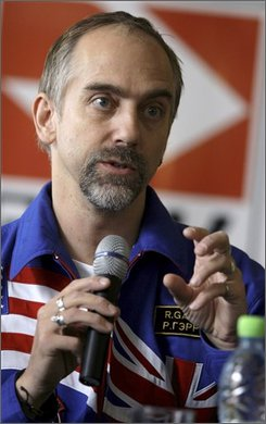 U.S. space tourist Richard Garriott speaks during his first news conference since returning to earth on Friday, in Star City, outside Moscow, Monday, Oct. 27, 2008. Garriott said Monday that NASA, the Russian space agency and other officials need to give private entrepreneurs broader access to the international space station. (AP Photo/Sergey Ponomarev)