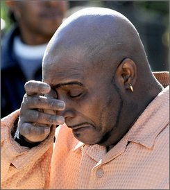 David Burrell, a friend of the Hudson family wipes tears after praying at a makeshift memorial outside the home belonging to the family of Oscar-winning actress Jennifer Hudson in Chicago, Sunday, Oct. 26, 2008. Hudson's mother Darnell Donerson and brother Jason Hudson were found dead. (AP Photo/Paul Beaty)