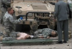 An image taken from a video shows US soldiers on the ground after a suicide attack at a police station in Pul-e-Khumri, the capital of Baghlan province, north of  Kabul, Afghanistan, Monday, Oct. 27, 2008. A suicide bomber wearing a police uniform blew himself up inside a police station in northern Afghanistan on Monday, killing two American soldiers and wounding five other people, officials said. (AP Photo/APTN)