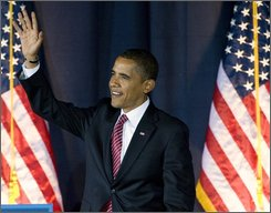 Democratic presidential candidate Sen. Barack Obama, D-Ill. waves at the beginning of his campaign stop at the Canton Civic Center in Canton, Ohio, Monday, Oct. 27, 2008.  (AP Photo/Phil Long)