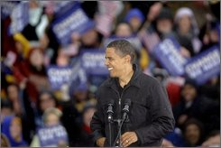 Democratic presidential candidate Sen. Barack Obama, D-Ill. is seen as rain falls during a rally in Chester, Pa., Tuesday, Oct. 28, 2008.  (AP Photo/Matt Rourke)