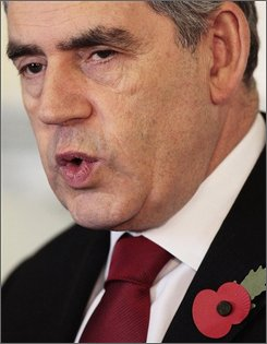 Britain's Prime Minister Gordon Brown speaks during a press conference in Downing Street, London, Tuesday Oct. 28, 2008. Brown said Tuesday  he wants China and oil-rich Gulf states to offer money for an enhanced IMF bailout fund aimed at helping countries rocked by the global economic downturn.  Brown told reporters that countries with the largest surpluses could do the most to help. (AP Photo/ Carl Court/PA)