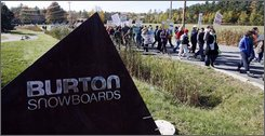 Protesters march in front of the Burton snowboard headquarters in Burlington, Vt., Thursday, Oct. 23, 2008. About 100 people gathered outside the Burton headquarters to demand that two lines of snowboards with images of naked Playboy models and cartoons of self-mutilation on Burton snowboards be pulled from the market.(AP Photo/Toby Talbot)