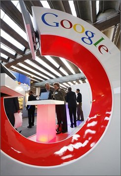 In this Oct. 11, 2007 file photo, visitors look at an information screen at the Google Book Search stand at the International Frankfurt Book Fair 'Frankfurter Buchmesse' in Frankfurt, Germany. A settlement has been reached Tuesday, Oct. 28, 2008, in the lawsuit against Google over the Internet search engine's use of copyrighted material. (AP Photo/Jens Meyer, file)