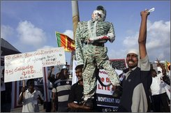 Members of the National Movement against Terrorism carry an effigy of Tamil Tiger leader Velupillai Prabhakaran during a protest in Colombo, Sri Lanka, Tuesday, Oct. 28, 2008. Protesters accused the government of the Indian state of Tamil Nadu for its interference in Sri Lanka's ethnic conflict and called for public support to defeat Tamil Tigers by ongoing military operations. The placard left reads ?Long Live the Brave Soldiers.? (AP Photo/Eranga Jayawardena)