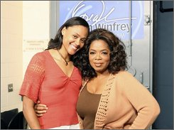 "In this photo released by Harpo Productions, Inc.,  former Olympic medalist Marion Jones, left, is shown with talk-show host Oprah Winfrey during taping of the ""The Oprah Winfrey Show,"" in Chicago on Oct. 24, 2008. Jones' appearance on the show airing Wednesday, Oct. 29 will be the disgraced track star's first interview since she was released Sept. 5 from a Texas federal prison after completing most of her six-month sentence for lying about steroid use. (AP Photo/Harpo Productions, George Burns)"