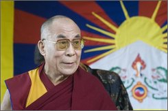 The Dalai Lama speaks to the students at the Tibetan Children's Village School in Dharmsala, India, where he attended the 48th founding anniversary of the school, Saturday, October 25, 2008. (AP Photo/Ashwini Bhatia)