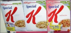 In this July 31, 2008 file photo, a Kellogg's cereal display is seen in a local store  in Tallahassee, Fla. Kellogg Co. said Wednesday, Oct. 29, 2008, strong sales of its cereals and snacks boosted profit 12 percent in the third quarter. (AP Photo/Phil Coale, file)