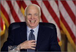 Republican presidential candidate Sen. John McCain, R-Ariz. laughs as he his photographed prior to participating in a National Security Roundtable, Wednesday, Oct. 29, 2008, at The University of Tampa in Tampa, Fla. (AP Photo/Carolyn Kaster)