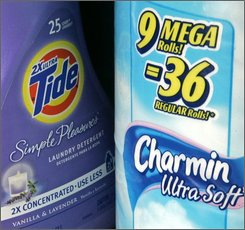 Procter & Gamble Co. hopes to attract consumers with products like Charmin mega rolls and Tide concentrated detergent, shown Sunday, Oct. 26, 2008, in Cincinnati, that offer more product for the dollar. Consumer products maker Procter & Gamble Co. said Wednesday, Oct. 29, 2008, profit rose nearly 9 percent in its fiscal first quarter, boosted by strong growth in emerging markets. (AP Photo/Al Behrman)